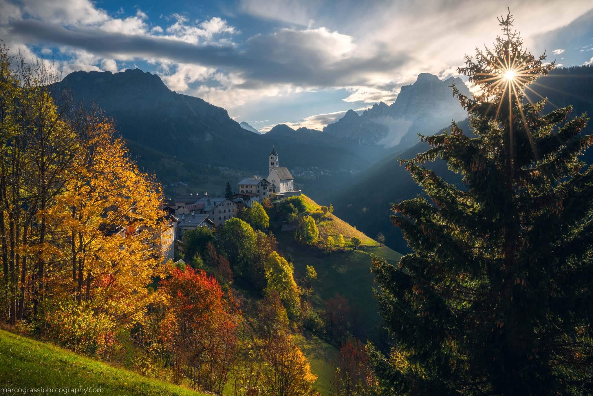 Sunrise at the church during the autumn Dolomites Photo Tour